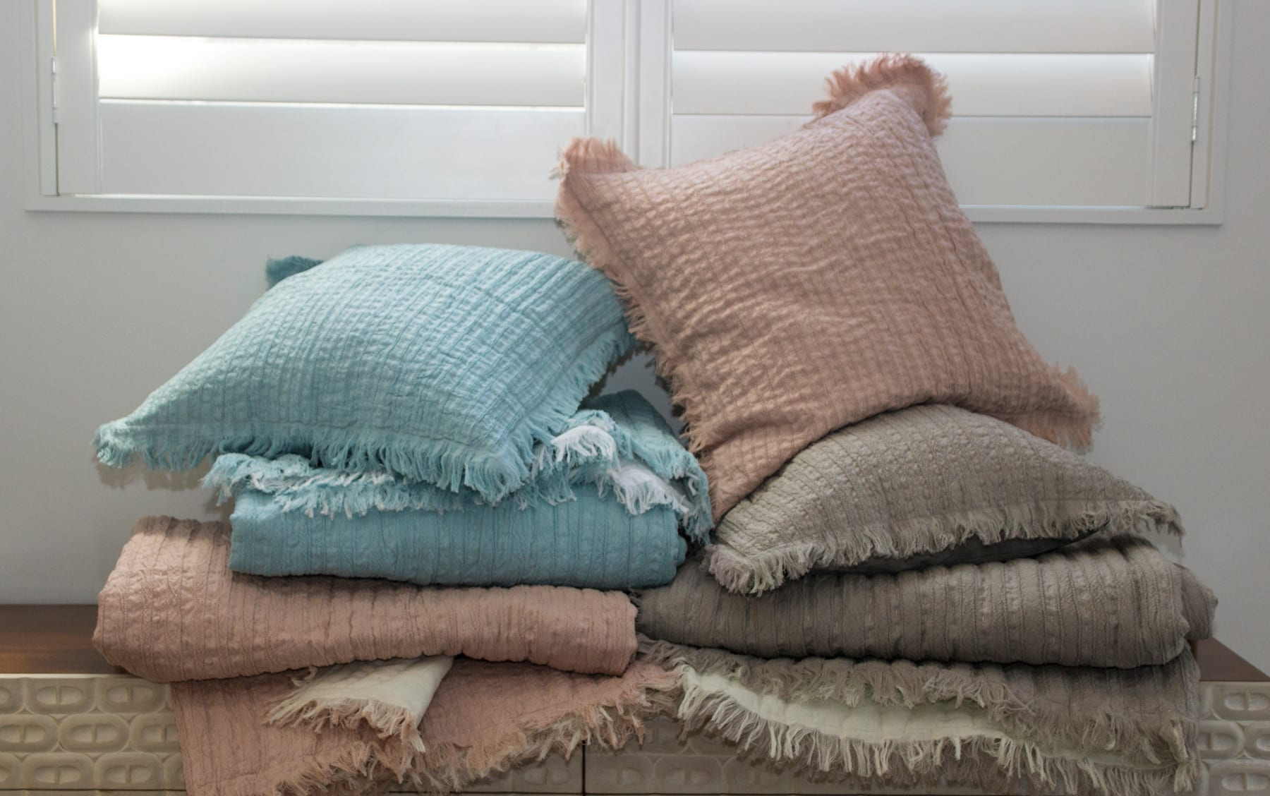 MM Linen Tali Throws & Cushions available at McKenzie & Willis